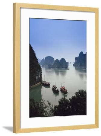 Vietnam, Halong Bay, Tourist Boats Anchor at the Cave of Marvels-Walter Bibikow-Framed Photographic Print