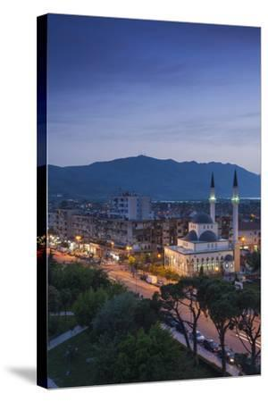 Albania, Shkodra, Elevated View of Zogu 1 Boulevard and Mosque, Dusk-Walter Bibikow-Stretched Canvas Print