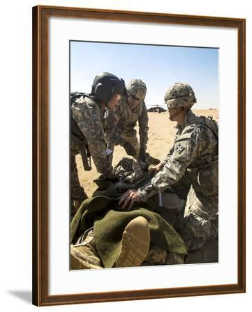 Soldiers Prepare to Load a Wounded Soldier onto a Uh-60 Black Hawk--Framed Photographic Print