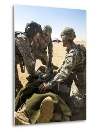 Soldiers Prepare to Load a Wounded Soldier onto a Uh-60 Black Hawk--Metal Print