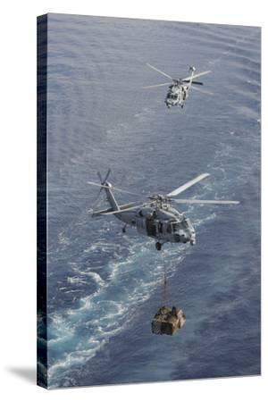 Two Mh-60S Sea Hawk Helicopters Transport Supplies--Stretched Canvas Print