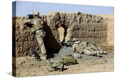 U.S. Marines Take Cover During a Patrol in Afghanistan--Stretched Canvas Print