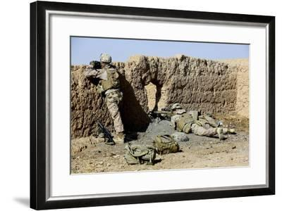 U.S. Marines Take Cover During a Patrol in Afghanistan--Framed Photographic Print