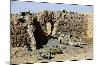 U.S. Marines Take Cover During a Patrol in Afghanistan--Mounted Photographic Print