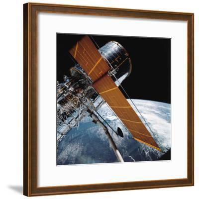 The Hubble Space Telescope Backdropped by Planet Earth--Framed Photographic Print