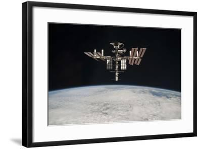 The International Space Station in Orbit Above Earth--Framed Photographic Print