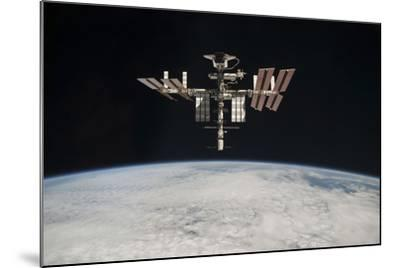 The International Space Station in Orbit Above Earth--Mounted Photographic Print