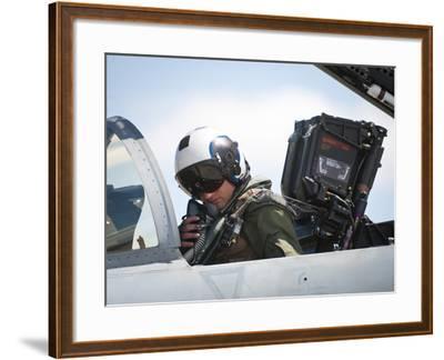 Naval Aviator Performs Pre-Flight Checks on an F-A-18C Hornet--Framed Photographic Print