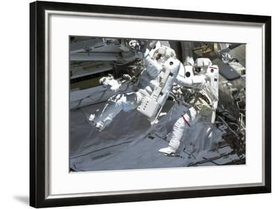 Astronauts Participate in a Spacewalk on the International Space Station--Framed Photographic Print