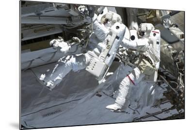 Astronauts Participate in a Spacewalk on the International Space Station--Mounted Photographic Print