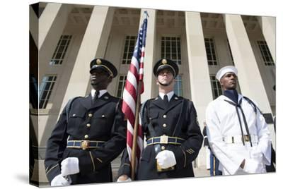 Members of the Honor Guard Stand at Attention in Front of the Pentagon--Stretched Canvas Print