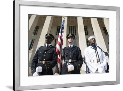 Members of the Honor Guard Stand at Attention in Front of the Pentagon--Framed Photographic Print