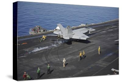 An F-A-18E Super Hornet Launches from USS Nimitz--Stretched Canvas Print