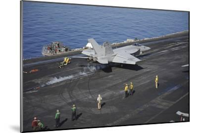 An F-A-18E Super Hornet Launches from USS Nimitz--Mounted Photographic Print