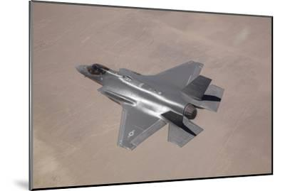 An F-35 Lightning Ii Flies over Edwards Air Force Base, California--Mounted Photographic Print