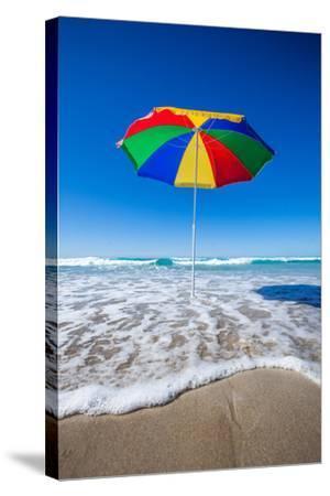 Umbrella at the Beach-John White Photos-Stretched Canvas Print