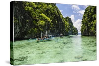 Outrigger Boats in the Crystal Clear Water in the Bacuit Archipelago, Palawan, Philippines-Michael Runkel-Stretched Canvas Print