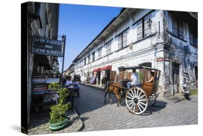 Horse Cart Riding Through the Spanish Colonial Architecture in Vigan, Northern Luzon, Philippines-Michael Runkel-Stretched Canvas Print