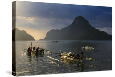 Outrigger Boat at Sunset in the Bay of El Nido, Bacuit Archipelago, Palawan, Philippines-Michael Runkel-Stretched Canvas Print