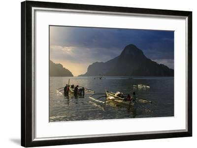 Outrigger Boat at Sunset in the Bay of El Nido, Bacuit Archipelago, Palawan, Philippines-Michael Runkel-Framed Photographic Print