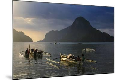Outrigger Boat at Sunset in the Bay of El Nido, Bacuit Archipelago, Palawan, Philippines-Michael Runkel-Mounted Photographic Print