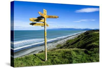 Signpost on Te Waewae Bay, Along the Road from Invercargill to Te Anau, South Island-Michael Runkel-Stretched Canvas Print
