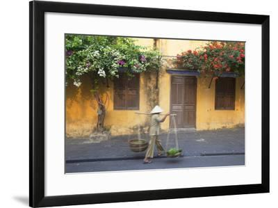 Woman Carrying Vegetables in Street, Hoi An, Quang Nam, Vietnam, Indochina, Southeast Asia, Asia-Ian Trower-Framed Photographic Print
