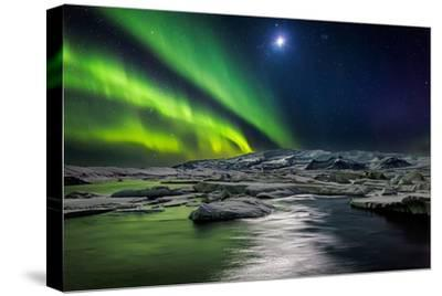 Moon and Aurora Borealis, Northern Lights with the Moon Illuminating the Skies and Icebergs--Stretched Canvas Print