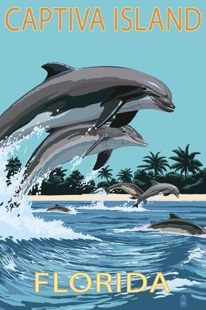 Captiva Island, Florida - Dolphins Swimming-Lantern Press-Framed Art Print