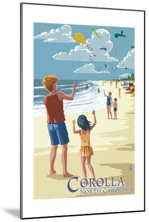 Corolla, North Carolina - Kite Flyers-Lantern Press-Mounted Art Print