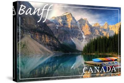 Banff, Canada - Moraine Lake Canoes-Lantern Press-Stretched Canvas Print