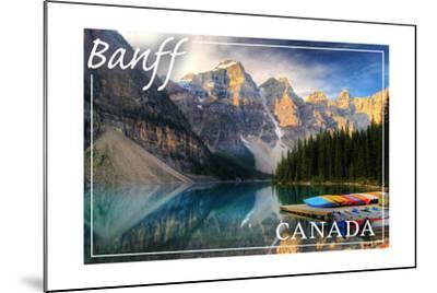 Banff, Canada - Moraine Lake Canoes-Lantern Press-Mounted Art Print