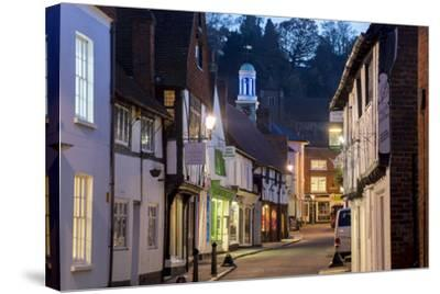 Traditional Street in Godalming is Lit at Dusk-Charles Bowman-Stretched Canvas Print