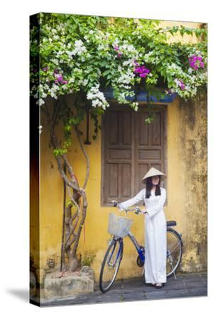 Woman Wearing Ao Dai Dress with Bicycle, Hoi An, Quang Ham, Vietnam-Ian Trower-Stretched Canvas Print