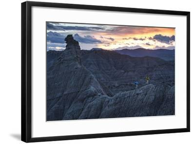 A Paleontologist and Volunteer Walk a Ridgeline in the Fossil Rich Badlands of Southern Utah-Cory Richards-Framed Photographic Print