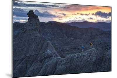 A Paleontologist and Volunteer Walk a Ridgeline in the Fossil Rich Badlands of Southern Utah-Cory Richards-Mounted Photographic Print