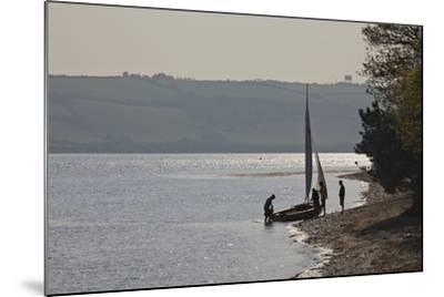 Launching a Sailing Dinghy at Mylor, on Carrick Roads, the Estuary of the River Fal, Near Falmouth-Nigel Hicks-Mounted Photographic Print