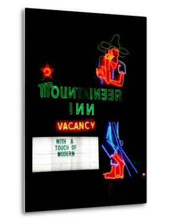 A Stereotypical Mountain Man Graces the Neon Sign of a Local Landmark-Amy and Al White and Petteway-Metal Print