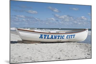A Rowboat Sits on the Beach in Atlantic City, New Jersey-Jeff Mauritzen-Mounted Photographic Print