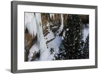 A Man Ice-Climbing the Fang, an Ice Formation on the Side of a Cliff-Keith Ladzinski-Framed Photographic Print