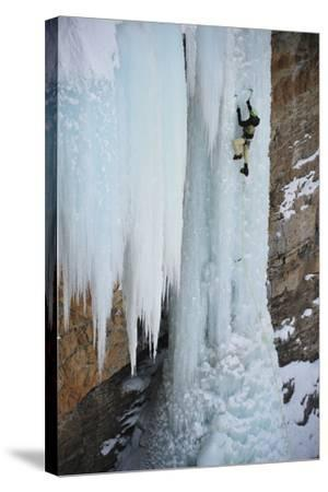 A Man Ice-Climbing the Fang, an Ice Formation on the Side of a Cliff-Keith Ladzinski-Stretched Canvas Print