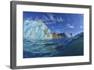 A Person Stand Up Paddle Boarding Near an Iceberg in the Fjords of Southeast Greenland-Keith Ladzinski-Framed Photographic Print