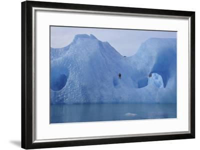 A Climber Navigates Tricky Terrain on a Blue Iceberg Off the Coast of Greenland-Keith Ladzinski-Framed Photographic Print