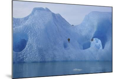 A Climber Navigates Tricky Terrain on a Blue Iceberg Off the Coast of Greenland-Keith Ladzinski-Mounted Photographic Print