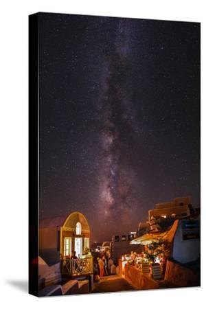 The Milky Way from Scorpius and Sagittarius, to Cygnus at Top, over Candle-Lit Restaurants-Babak Tafreshi-Stretched Canvas Print