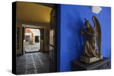 Carved Wooden Angels Guard a Hallway in the Restored 1730 Mansion Casa De Moral-Beth Wald-Stretched Canvas Print