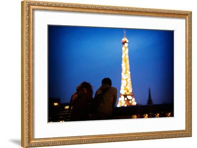 A Couple Watch the Eiffel Toer Glitter at Night in Paris, France-Chris Bickford-Framed Photographic Print