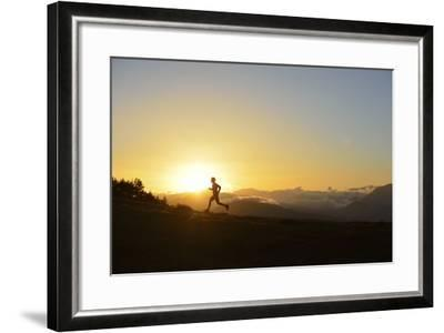 A Silhouetted Man Running Near the Verdon Gorge at Twilight-Keith Ladzinski-Framed Photographic Print