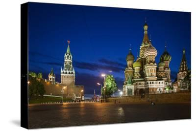 Spasskaya Tower, also Called Savior's Tower, and Saint Basil's Cathedral at Night-Kent Kobersteen-Stretched Canvas Print