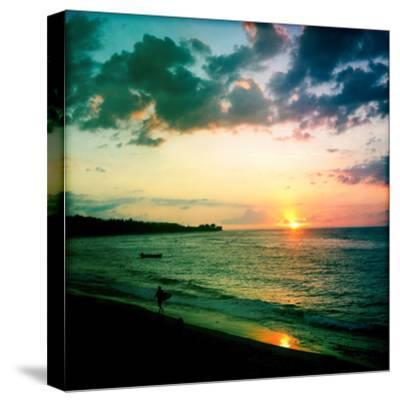 A Surfer Heading Home at Sunset on Shacks Beach Near Aquadilla, Puerto Rico-Skip Brown-Stretched Canvas Print